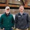 BEN GARVER — THE BERKSHIRE EAGLE<br /> Narain Schroeder, Director of Land Conservation,<br /> Berkshire Natural Resources Council, Inc., and Dennis Regan Berkshire director of the Housatonic Valley Association (with hat) reveal the new Housatonic Canoe access on Division Street in Great Barrington, Thursday, April 18, 2019. A great deal of effort in the project was clearing invasive species from the site.