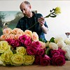 BEN GARVER — THE BERKSHIRE EAGLE<br /> Tuesday is the day fresh flowers are delivered to Township Four a floristry and home shop  co-owned by Jed Thompson and Nathan Hanford, North Street in Pittsfield. Thompson sorts a batch of mixed roses for display, Tuesday, April 16, 2019.