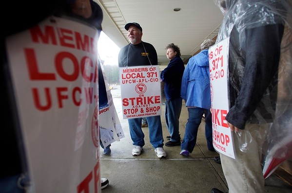 BEN GARVER — THE BERKSHIRE EAGLE<br /> Strikers at Stop & Shop at Dan Fox Drive in Pittsfield take cover from the rain outside the store on the fourth day of the strike, Monday, April 15, 2019.
