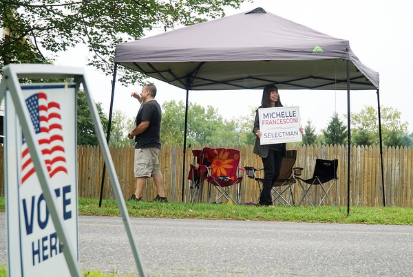 BEN GARVER — THE BERKSHIRE EAGLE<br /> Lynn Melchiori holds a sigh for her daughter, Michelle Francesconi, outside of the Community Center in Cheshire during voting for two new selectman seats, Tuesday, August 13, 2019.