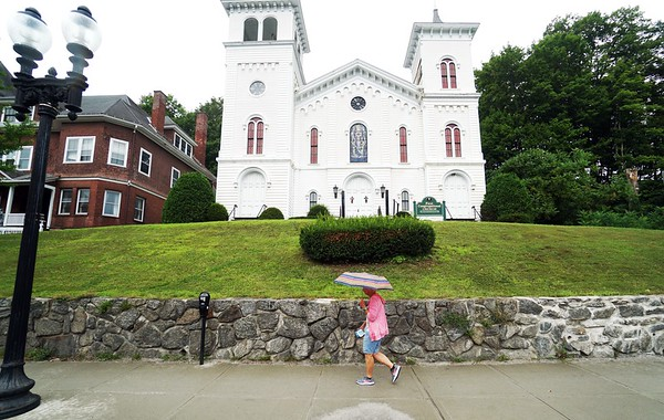 BEN GARVER — THE BERKSHIRE EAGLE<br /> A woman strolls past the First Congregational Church in Adams on Park Street, Tuesday, August 13, 2019.