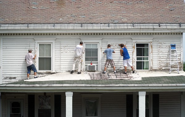 BEN GARVER — THE BERKSHIRE EAGLE<br /> Painters from Red White and Blue Painting  scrape and prep the exterior of 66 Park Street in Adams, TUesday, August 13, 2019.