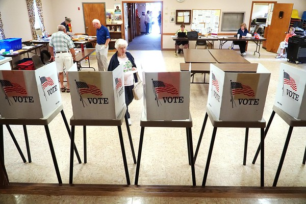 BEN GARVER — THE BERKSHIRE EAGLE<br /> A woman approaches the polling booths at the Community Center in Cheshire to vote for the Select Board race, Tuesday, August 13, 2019.