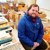 BEN GARVER — THE BERKSHIRE EAGLE<br /> Robert Ireland, development director for the Lenox Library, Friday, November 15, 2019. Ireland oversees the fate of a donated book, in fact, thousands of them.  The books appear in the Book Nook at the Library, at the annual book sale or adre donated to libraries that can use them.