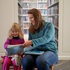 BEN GARVER — THE BERKSHIRE EAGLE<br /> Kim Davis reads to her daughter Skye, age 4, at the Stockbridge Library because it was just a little to cold for a hike. Wednesday, November 13, 2019.
