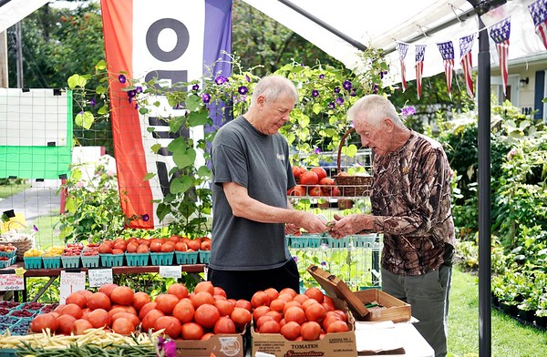 BEN GARVER — THE BERKSHIRE EAGLE<br /> Don Usher buys some green beans from Farmer Don's Farm Stand (Don Rawson) on Housatonic Street in Lenox, Tuesday, September 3, 2019. Rawson grows the vegetables at the stand and some specialty items from local farms.