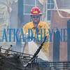 A firefighter sprays water on the remaining flames in the burned out RV. Fran Ruchalski/Palatka Daily News