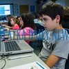 Jacob Felton, 10, and Lillian Buckles, 8, go through a computer coding exercise during the Generation Mars: Technology Training Camp program at the Palatka library on Monday afternoon. Fran Ruchalski/Palatka Daily News