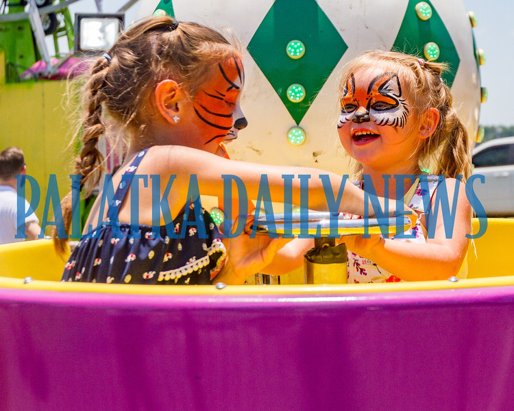 Adriana Morales-Diaz, 6, and Scarlett Brady, 3 of Deland enjoy spinning around in the tea cup ride on Saturday afternoon. Fran Ruchalski/Palatka Daily News