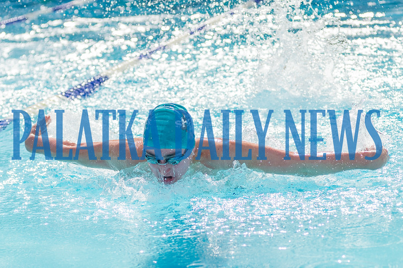 Brady Weaver swims the butterfly during the 100 Yard Individual Medley.