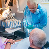 Volunteer dentist Stephen Beckett, D.D.S. discusses the treatment he will be doing with patient Merle Carlisle of Crescent City on Friday afternoon. Fran Ruchalski/Palatka Daily News