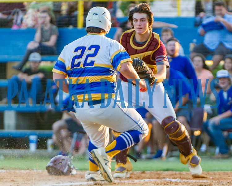 Palatka senior Clay Sipprell attempts to make it home, but can't get by Crescent City sophomore Dylan Hutchinson of the visiting team in the Putnam County All-Star Game on Thursday night. Fran Ruchalski/Palatka Daily News