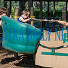 Four-year-old Luke York and Heaven Vaughan get a push on the Sway Fun ride from Anthony Nacci at the playground at Francis Sports Complex on Tuesday afternoon. Fran Ruchalski/Palatka Daily News