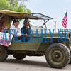 World War II Navy frogman Charles LaFontaine, 96, rides in a historic military Jeep as the grand marshall of the Memorial Day parade. Fran Ruchalski/Palatka Daily News