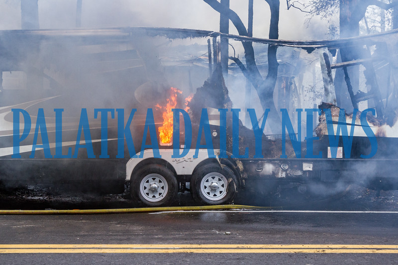Flames shoot up in the burned-out RV at the fire on Lake Como Drive on Tuesday afternoon. Fran Ruchalski/Palatka Daily News