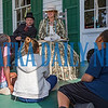 Gina and Brian Gilvey tell students about life during the Civil War in 1864 as they sit on the front porch of the Bronson-Mulholland House during Occupation Palatka on Friday morning. Fran Ruchalski/Palatka Daily News