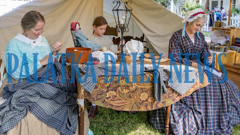 Ladies of the Golden Teacups, from left,Terri Blocker, Lauren Aponte, 12, and Jean Dominguez sew during Occupation Palatka on Friday morning. Fran Ruchalski/Palatka Daily News