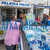 Police and city personnel line up to load cases of water donated for the Bahamas into a police trailer. Fran Ruchalski/Palatka Daily News