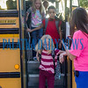 Kids jump off the bus on their first day of school at Interlachen Elementary School on Monday morning. Fran Ruchalski/Palatka Daily News