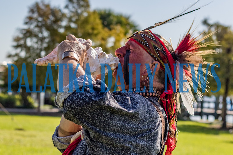 Jim Sawgrass of the Florida Muskogee Creek Tribe as The Long Warrior blows into a conch shell to start the Bartram Frolic learning experience for schoolchildren on Tuesday morning. Fran Ruchalski/Palatka Daily News
