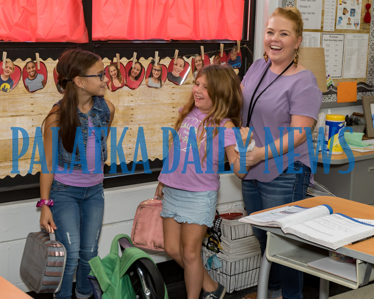 Kelley Smith Elementary teacher Lanna Barican, right, was very surprised she received a $500 grant from the Palatka Young Professionals to add some STEM materials for her students. She is standing with students Brooke Schnarow and Amelia Robbins. Fran Ruchalski/Palatka Daily News