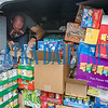 Police Captain Matt Newcomb tries to find more space for some of the donated food for the Bahamas in a police van. Fran Ruchalski/Palatka Daily News