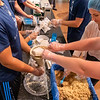 St. Johns River State College students pack oatmeal and brown sugar meals for the Feed the Need program in the Viking Center on Tuesday afternoon. Fran Ruchalski/Palatka Daily News