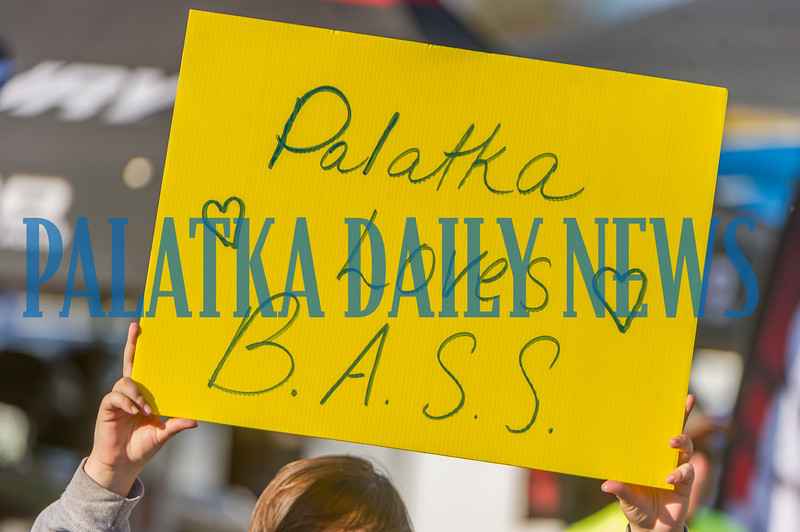 This youngster holds up a sign at the weigh-in of the first day of the Bassmaster Elite tournament on Thursday afternoon to let the anglers know how much they're loved in Palatka. Fran Ruchalski/Palatka Daily News