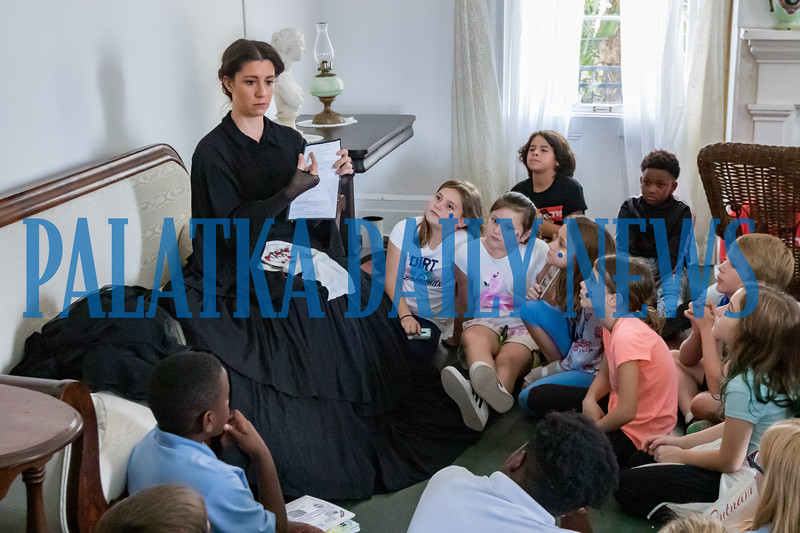 Breanna Pierce tells school children about how widows dealt with their lives during the Civil War in the sitting room of the Bronson-Mulholland House during Occupation Palatka on Friday morning. Fran Ruchalski/Palatka Daily News