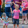 Karlee Dockery, 3, looks to see what's coming next as Saydee Dockery, 6, waves her flags as the Memorial Day parade goes by them on Monday morning. Fran Ruchalski/Palatka Daily News