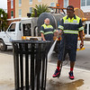 Palatka Public Works employees Tremaine R. Watts uses a pressure washer to do some cleaning at the riverfront while supervisor Russell Cox controls the pressure from the truck on Friday afternoon. Fran Ruchalski/Palatka Daily News