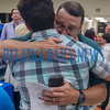 Winner of the Robert W. Webb Award of Excellence Justin Darcey gets an emotional hug from his father, Jesse Darcey. Fran Ruchalski/Palatka Daily News