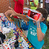 Blake Hayes, 7, foreground, reaches for something he sees in outer space while wearing virtual reality goggles at the library's table at the PCSD STEM Carnival on Thursday afternoon with Noah Harvey, 9, Zacharee Harvey, 6, and Jonah Harvey, 8,<br /> The Putnam County School District hosted the carnival at the PCSD Training Center where students demonstrated their projects with robots, drones, coding and software, competing for prizes in a friendly competition. The idea is to spark interest in Science, Technology, Engineering and Mathematics in kids, making the learning fun and preparing them for technology careers in the future. Fran Ruchalski/Palatka Daily News
