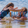 Chloe Polgar, 9, from left, Braysen Abby, 2, and Mike Stoltz enjoy a fun family swim in Lake Stella in Crescent City on Monday afternoon. Fran Ruchalski/Palatka Daily News