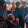 Classmates gather around Jarvarious Boynton-DeWitt to congratulate him on his graduation. Fran Ruchalski/Palatka Daily News