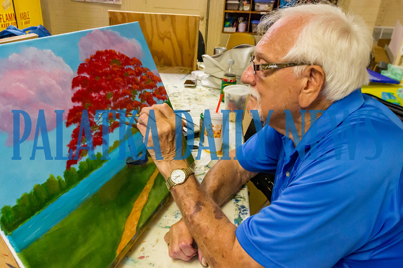 Richard Brooks adds a few dabs of paint to his latest masterpiece during the Underground Arts Tuesday afternoon group get-together at the Larimer Arts Center. Fran Ruchalski/Palatka Daily News