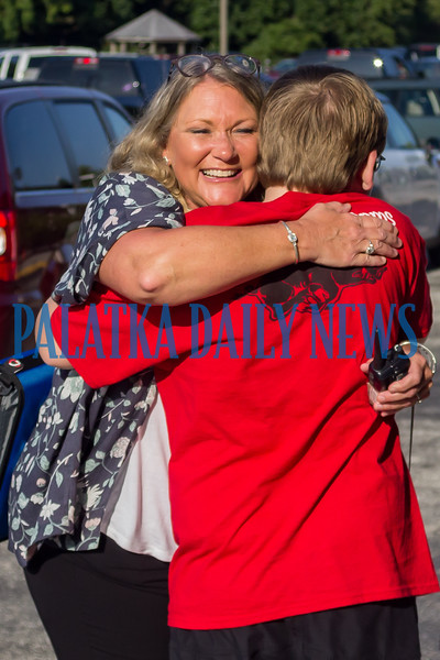 C. H. Price Middle School principal Mechele Higginbotham gets a big hug from one of her students on the first day of school. Fran Ruchalski/Palatka Daily News