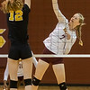 Raiders Junior Jordan Brady (7) puts a shot by Miners senior Hannah Rast (12). Fran Ruchalski/Palatka Daily News
