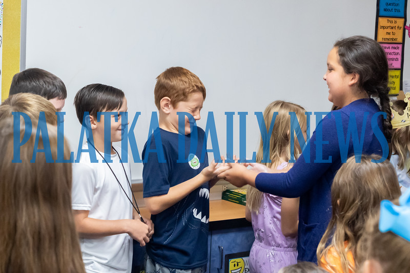 After learning about the importance of hand washing, third grade students at Kelley Smith Elementary see how easy it is to pass germs from one person to another. Fran Ruchalski/Palatka Daily News
