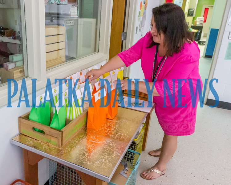 Lara Shettel arranges goodie bags for her 4th grade class at Browning-Pearce Elementary School on Tuesday morning as she gets ready for the opening of the new school year. Fran Ruchalski/Palatka Daily News