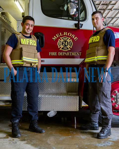 Melrose firefighters Kayvon Yazdan, left, and Garrett Videon don two of the four new Ballistic Armor protective vests that the fire company has just put into service. Fran Ruchalski/Palatka Daily News