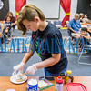 Eleven-year-old Pipar Gigon spoons out 20 teaspoons of shortening which is the equivalent of the fat contained in a standard Whopper with cheese at the Cooking Matters for Chefs and Kids demonstration at the Palatka Library on Monday afternoon where children learned more about fat content in common foods. Fran Ruchalski/Palatka Daily News