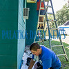 Christopher Sokol, 17, and Kim Dinkins paint a house in the 1100 blk. of N. 12th St. in Palatka. They are working in Putnam County as part of the Urban Plunge program run by the Diocese of St. Augustine that allows teens to perform home improvement services for residents in need. Fran Ruchalski/Palatka Daily News