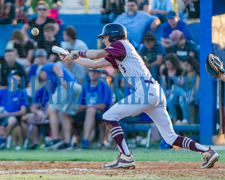 Crescent City senior Dylan Cummings bunts one for the home team in the Putnam County All-Star Game on Thursday night. Fran Ruchalski/Palatka Daily News