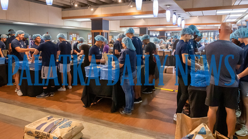 St. Johns River State College students and staff pack dinners for the Feed the Need program in the Viking Center on Tuesday afternoon. Fran Ruchalski/Palatka Daily News