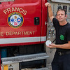 Firefighter Jason Matchett stands outside the Francis Volunteer Fire Department holding a smoke detector to let people know it is Fire Prevention Month. Members of area departments are installing smoke detectors and other services to keep area residences safe. Fran Ruchalski/Palatka Daily News