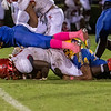 Palatka defenders David Williams (34) and Demontae Ashley (14) converge to stop Santa Fe fullback Darrius Powell (5) in their game Friday night. Fran Ruchalski/Palatka Daily News