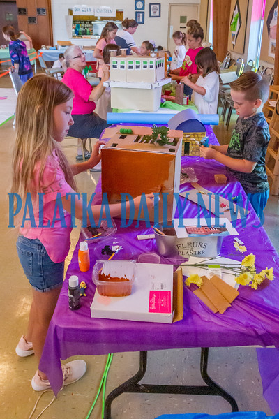 Campers work on their versions of Palatka buildings and those they'd like to see at the third Palatka Box City Art Camp on Tuesday morning. Fran Ruchalski/Palatka Daily News