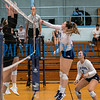 Freshman middle blocker Brooklyn McLeod (9)