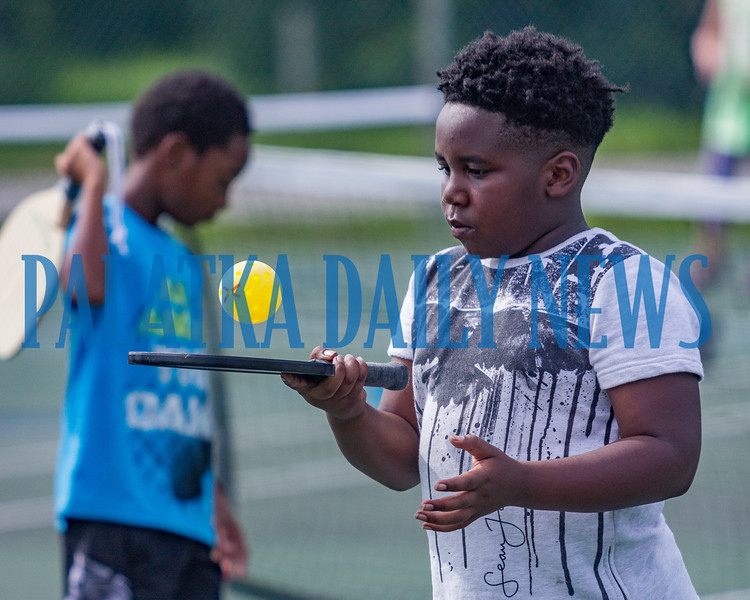 "Nine-year-old Michael Colson hits a ""selfie"" at the Youth Pickleball Introductory Clinic at the John Theobold Sports Complex on Thursday morning. The clinic was one of several events Putnam County Parks & Recreation organized to celebrate Park and Recreation Month. Fran Ruchalski/Palatka Daily News"